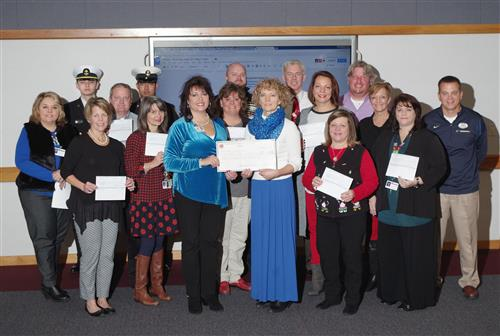 ACS administrators and Junior ROTC  students accepting checks from Taylorsville Hometown Development