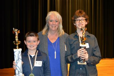 Spelling Bee Winners with Associate Superintendent Dr. Curry